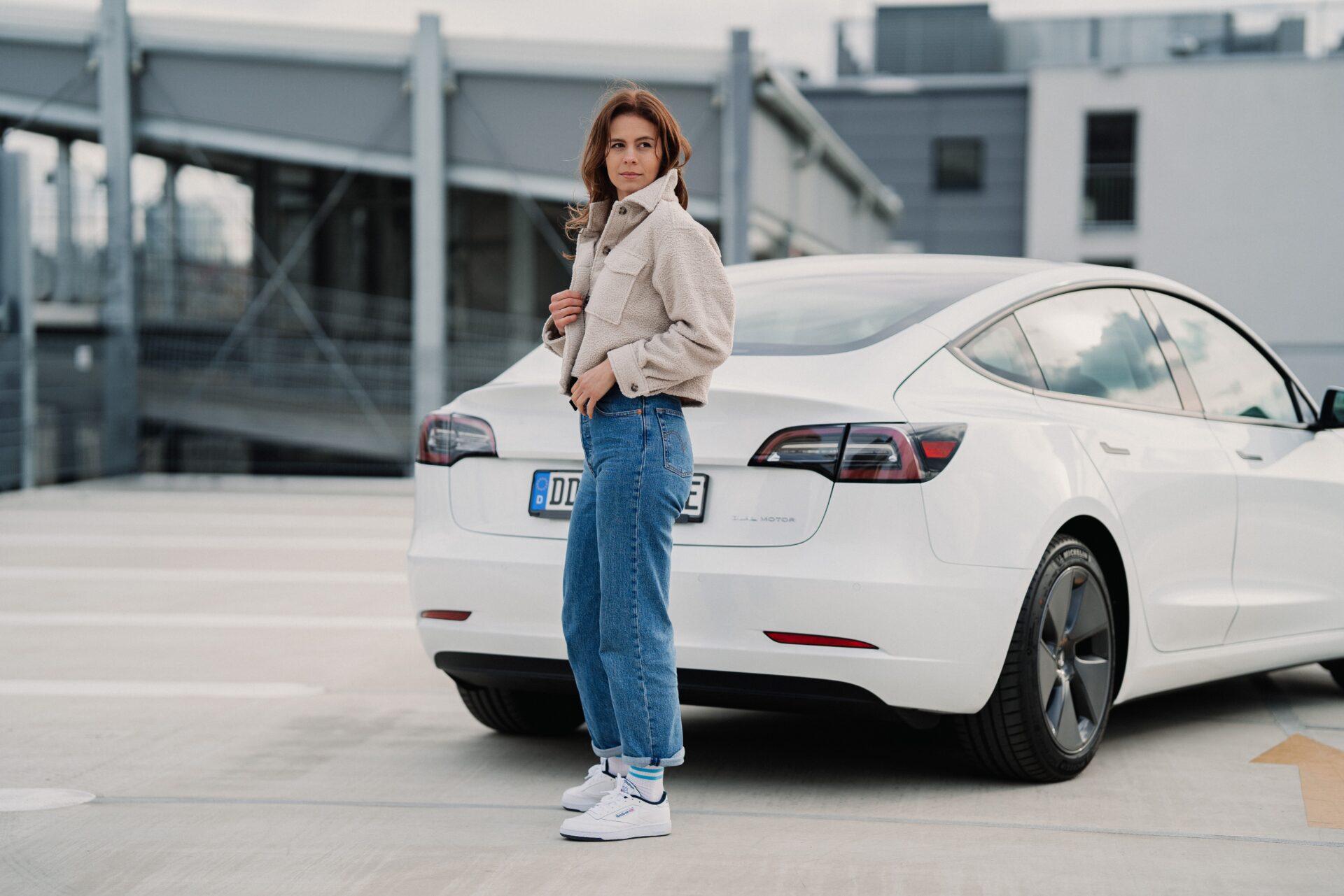 Woman with Tesla