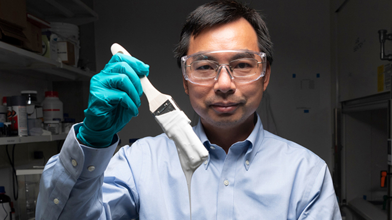 Xiulin Ruan, a Purdue University professor of mechanical engineering, and his students have created the whitest paint on record. (Purdue University photo/John Underwood)